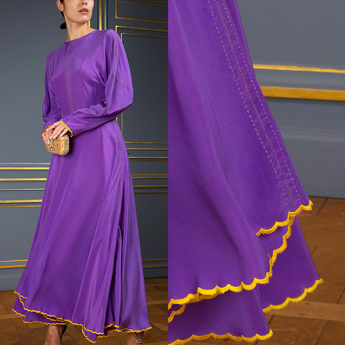 Parma-violet long-sleeved gown with golden-yellow ric-rac trim
